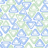 Seamless vector background with simple triangle shapes in light green and blue on white background Royalty Free Stock Images