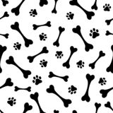 Seamless vector background of the tracks, the bones of dogs or animals. Black and white illustration stock photo