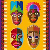 Seamless vector border with Australian boomerangs and African masks. Stock Images
