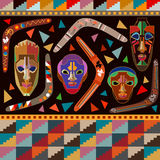 Seamless vector border with Australian boomerangs and African masks. Inspired by aboriginal art. Ethnic textile collection Royalty Free Stock Images
