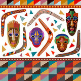 Seamless vector border with Australian boomerangs and African masks. Inspired by aboriginal art. Ethnic textile collection Royalty Free Stock Photo