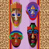 Seamless vector border with shamanic masks and animal prints. Stock Images