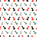 Seamless vector chaotic pattern with black, grey and red chess pieces. Stock Photos