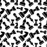 Seamless vector chaotic pattern with grey and black chess pieces. Stock Photography