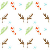 Seamless vector Christmas texture. Seamless backdrop with pine tree, candy cane, deer horns and snowflakes. Royalty Free Stock Image
