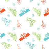 Seamless vector Christmas texture. Seamless backdrop with pine tree, gift box, christmas decoration, holly berry, snowflakes. Stock Photos