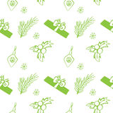 Seamless vector Christmas texture. Seamless backdrop with pine tree, gift box, christmas decoration, holly berry, snowflakes. Stock Photo