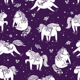 Seamless vector cute pattern with adorable unicorns in cartoon style Stock Image