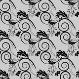 Seamless vector floral pattern. Stylized silhouettes of flowers Stock Photos
