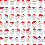 Seamless vector illustration of the faces of Santa Stock Photography