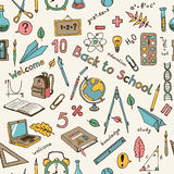 Seamless vector light background with school items in sketch sty Stock Images