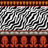 Seamless vector pattern with animal prints and ancient geometrical ornaments. Stock Photos