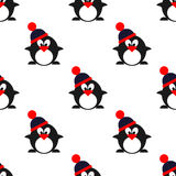 Seamless vector pattern with animals, cute symmetrical  background with penguins with winter hats Stock Photography
