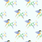 Seamless vector pattern with animals. Symmetrical background with colorful birds, leaves and flowers on the light backdrop Royalty Free Stock Images