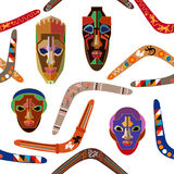 Seamless vector pattern with Australian boomerangs and African masks. Design inspired by aboriginal art. Ethnic textile collection Stock Photography