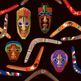 Seamless vector pattern with Australian boomerangs and African masks. Design inspired by aboriginal art. Ethnic textile collection Stock Photos