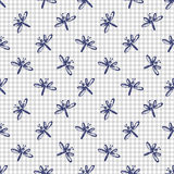 Seamless vector pattern, background with cute dragonflies on the chekered paper. Royalty Free Stock Images