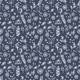 Seamless vector pattern, background with flowers and leaves on the blue backdrop. Stock Photo