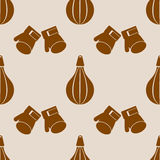 Seamless vector pattern.  Background with grey sports equipment. Punching bag and gloves on the beige backdrop Stock Image