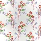 Seamless vector pattern, background with roses, branches and leaves on the checkered backdrop. Royalty Free Stock Image