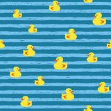 Seamless vector pattern - bath ducks on blue stripes Stock Image