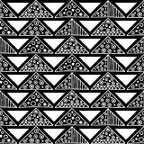 Seamless vector pattern. Black and white geometrical background with hand drawn decorative tribal elements. Print with ethnic, fol Royalty Free Stock Photography