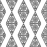 Seamless vector pattern. Black and white geometrical background with hand drawn decorative tribal elements. Print with ethnic, fol Stock Images