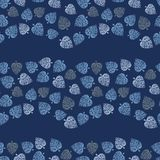 Seamless vector pattern with blue leaves forming wavy stripes on dark background vector illustration
