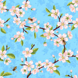 Seamless vector pattern from the branches of a spring blooming apple tree with pink flowers, leaves and bees. Against the blue sky vector illustration