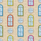 Seamless Vector Pattern with Brick Wall and Color Windows Royalty Free Stock Photography