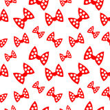 Seamless vector pattern, bright chaotic background with red bows, on the white backdrop Stock Photography