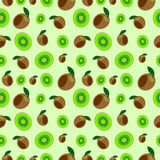 Seamless vector pattern,  bright  fruits chaotic background with kiwi, whole and half over light green backdrop Royalty Free Stock Photography