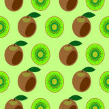 Seamless vector pattern,  bright  fruits symmetrical background with kiwi, whole and half Royalty Free Stock Photo