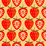 Seamless vector pattern,  bright symmetrical background with strawberry, whole and half over light orange backdrop. Royalty Free Stock Photography