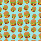Seamless vector pattern with burger image. Cheeseburger blue background. Stock Photo
