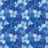 Seamless vector pattern with butterfly shapes in shades of blue royalty free illustration