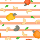 Seamless vector pattern of cashew nut. Striped background with delicious  nuts, leaves. Illustration can be used fo Stock Photos