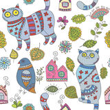 Seamless vector pattern with cats, birds, leaves and flowers Royalty Free Stock Image