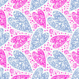 Seamless vector pattern. Chaotic background with closeup decorative blue and pink hearts Royalty Free Stock Photo