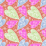 Seamless vector pattern. Chaotic background with closeup decorative colorful hearts Royalty Free Stock Photos