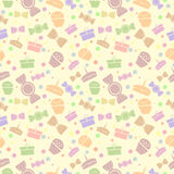 Seamless vector pattern. Chaotic pastel background with colorful sweets and gifts on the light yellow backdrop Stock Photos