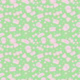 Seamless vector pattern. Chaotic pastel background with pink sweets and gifts on the green backdrop Stock Photos