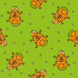 Seamless vector pattern for children. Tiger cub top view and chamomile on a green background. Seamless vector pattern for children. Tiger cub top view and Stock Images