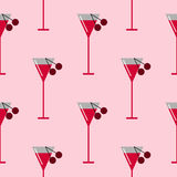 Seamless vector pattern with cocktails and cherries on the pink background. Stock Photos