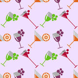 Seamless vector pattern with cocktails, wine, cherries, oranges and grape on the light pink background. Royalty Free Stock Photography