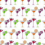 Seamless vector pattern with cocktails, wine, cherries, oranges and grape on the white background. Royalty Free Stock Photos