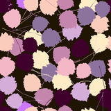 Seamless vector pattern of colorful aspen leaves on a dark brown Royalty Free Stock Photos