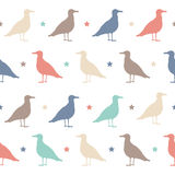 Seamless vector pattern with colorful birds and stars. Happy Halloween party. Royalty Free Stock Photo