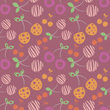 Seamless vector pattern with colorful different decorative ornamental cherries on the violet background. Repeating ornament. Stock Photos