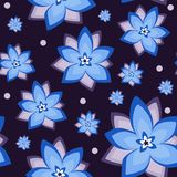 Seamless vector pattern with cornflower. Seamless floral vector pattern. Blue cornflower and white dots on purple background. For textile wallpaper and royalty free illustration
